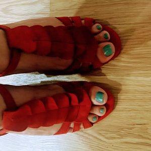 Red suede wedge heels.